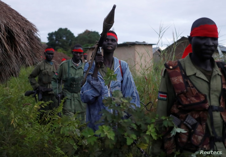 SPLA-IO (SPLA-In Opposition) rebels walk during an assault on government SPLA (Sudan People's Liberation Army) soldiers in the…