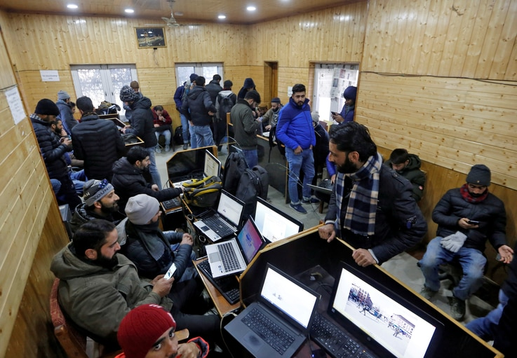 FILE PHOTO: Journalists use the internet as they work inside a government-run media centre in Srinagar January 10, 2020...