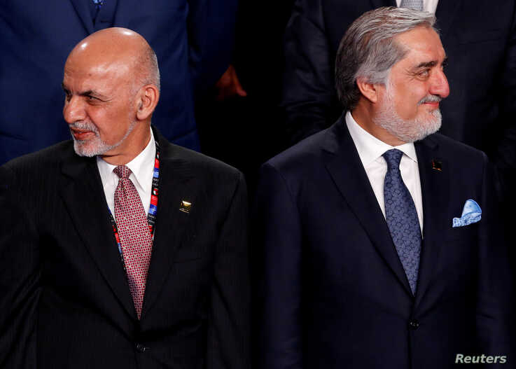 FILE PHOTO: FILE PHOTO: Afghanistan's President Ashraf Ghani (L) and Afghanistan's Chief Executive Abdullah Abdullah (R)…