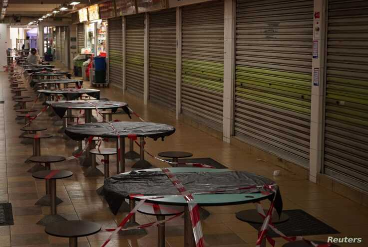 A view of shuttered stalls at Hong Lim Hawker Centre amid the coronavirus disease (COVID-19) outbreak, in Singapore May 10,…