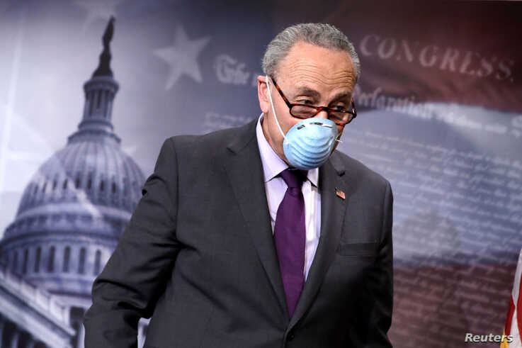 U.S. Senate Minority Leader Chuck Schumer (D-NY) leaves after a news conference on the response to the coronavirus disease …