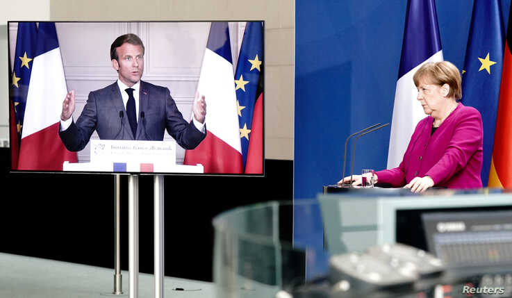 FILE PHOTO: German Chancellor Angela Merkel holds a joint video news conference with French President Emmanuel Macron in Berlin…