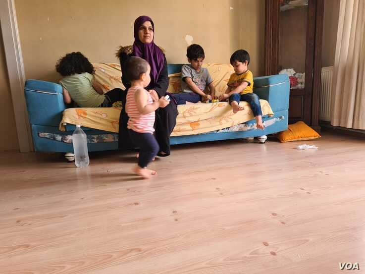 Marwa plays with four of her five children in a home in Istanbul, May 20, 2020. This month's payment was made by a charity, but Marwa doesn't know how next month's payment will be covered. (VOA/Heather Murdock)