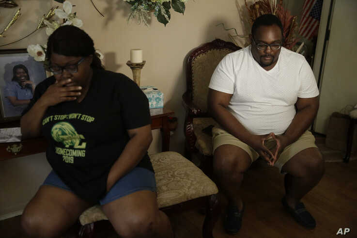 Cousins Latasha Taylor, left, and Desmond Tolbert sit during an interview on Saturday, April 18, 2020 in Dawson, Ga. Both have…