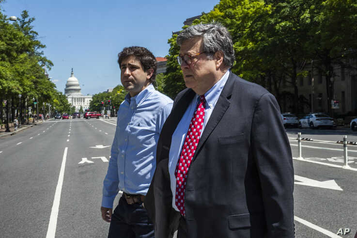 Attorney General William Barr crosses Pennsylvania Avenue NW from the Department of Justice building, May 30, 2020.