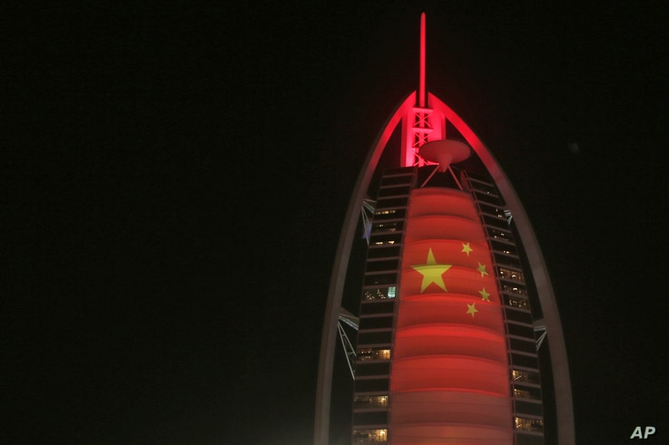 In this Wednesday, July 18, 2018 photo, the Chinese flag is projected onto the Bus Al Arab luxury hotel to celebrate the UAE…
