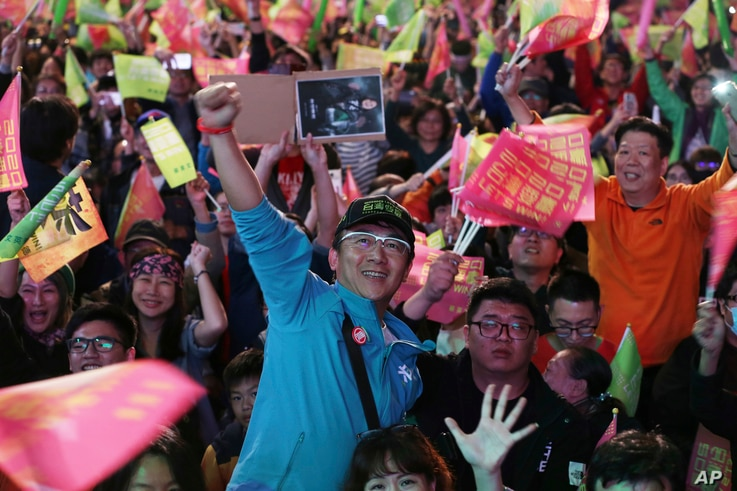 Supporters of Taiwan's 2020 presidential election candidate, Taiwan president Tsai Ing-wen cheer for Tsai's victory in Taipei,…