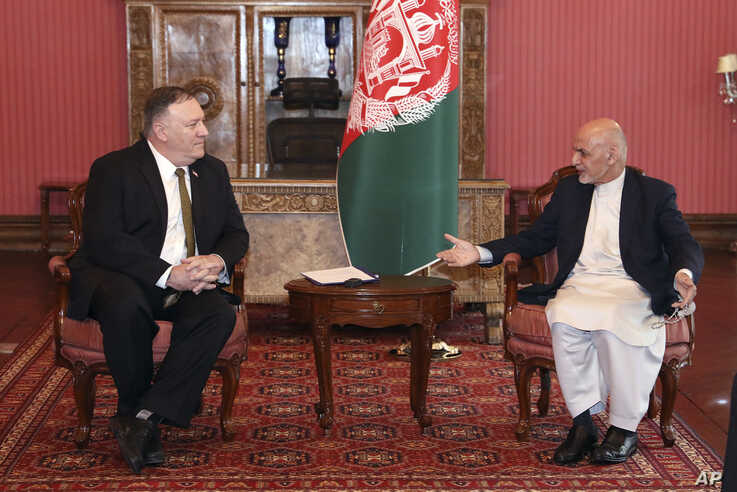 U.S. Secretary of State Mike Pompeo, left, meets with Afghan President Ashraf Ghani, at the Presidential Palace in Kabul,…