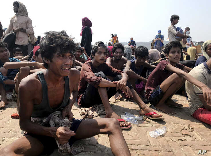 Rohingya refugees react after being rescued in Teknaf near Cox's Bazar, Bangladesh, Thursday, April 16, 2020. Bangladesh's…