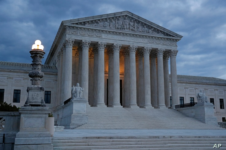 Clouds roll over the Supreme Court at dusk on Capitol Hill in Washington, May 3, 2020.