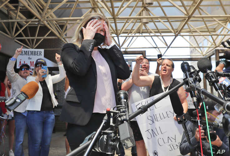 Salon owner Shelley Luther reacts as supporters chant for her after she was released from jail in Dallas