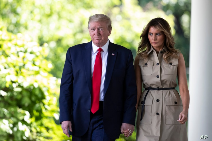 President Donald Trump and first Lady Melania Trump arrive for a White House National Day of Prayer Service in the Rose Garden.