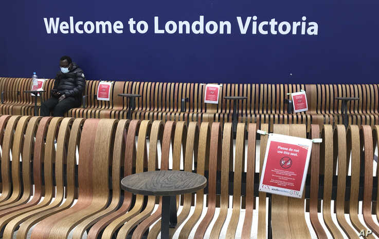 Seats displaying social distancing signs at Victoria Station, London, Monday, May 11, 2020, as the country continues in…