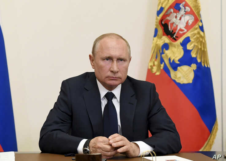 Russian President Vladimir Putin, addresses the nation via video conference at the Novo-Ogaryovo residence outside Moscow, Russia, May 11, 2020.