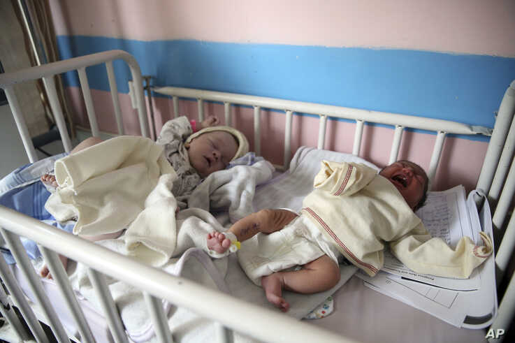 Newborn babies lie in their beds at the Ataturk Children's Hospital a day after they were rescued from a deadly attack on…