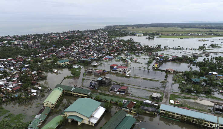 Floodwaters caused by typhoon Vongfong inundate a village as it passed by Sorsogon province, eastern Philippines on Friday May…