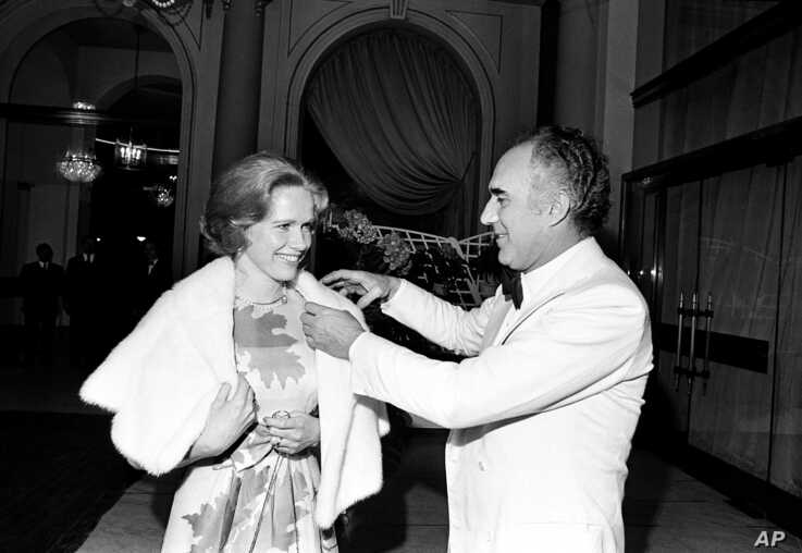 FILE - French actor Michel Piccoli talks with Swedish actress Liv Ullmann at the Cannes Film Festival, southern France, May 20, 1974.