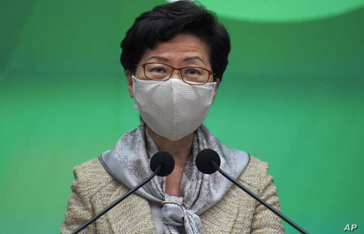 Hong Kong Chief Executive Carrie Lam listens to reporter's question during a press conference in Hong Kong, Tuesday, May 19, 2020.