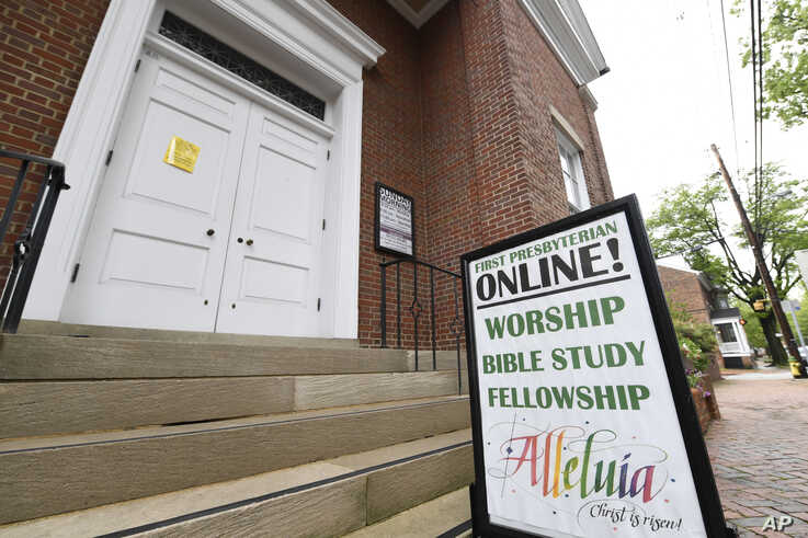 The sign for First Presbyterian Church of Annapolis, Md., displays information for online services, Friday, May 22, 2020…