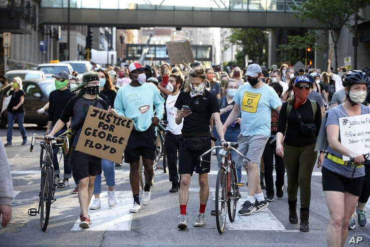 Hundreds of protesters marched through downtown Minneapolis after a protest at the Hennepin County Government Center Thursday, May 28, 2020.