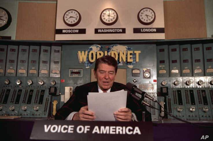 President Ronald Reagan gives his weekly radio address, Saturday, November 9, 1985, at the Voice of America studio in…