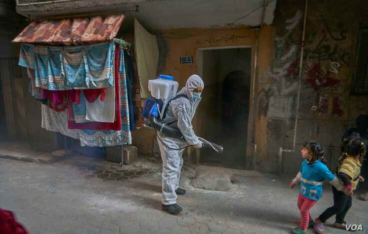 Some disinfecting work took place in densely populated neighborhoods like Al-Zawya Al-Hamra in Cairo to stem the spread of the…