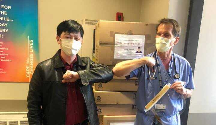 Dinh Tran Tuan with Dr. Gerry Gacioch after Tuan's delivery of face shields to Rochester General Hospital, April 13, 2020. (Courtesy of Dinh Tran Tuan)