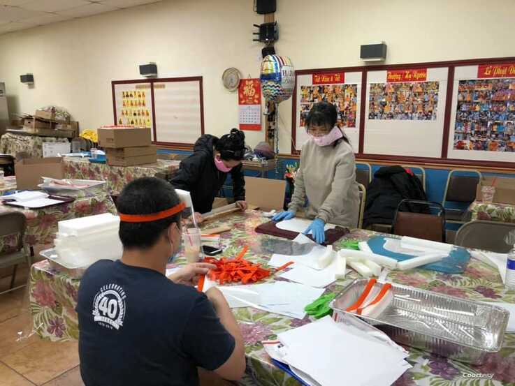 Team members work on face shields at Thanh Tinh Buddhist Temple, April 19, 2020. Around 1,000 face shields were made that weekend, according to the temple's Facebook account. (Photo courtesy of Dinh Tran Tuan)