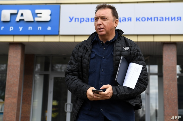 FILE - Russian oligarch Oleg Deripaska is seen outsite his GAZ car production plant in Nizhny Novgorod, Russia, April 16, 2019.