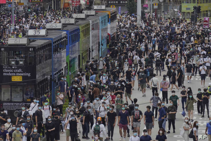 Pro-democracy protesters march during a protest against Beijing's national security legislation in Hong Kong, May 24, 2020.