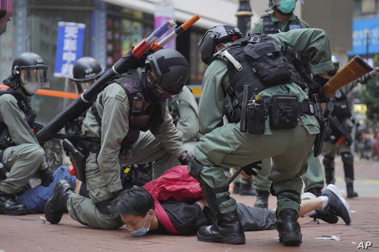 Riot police detain a protester during a demonstration against Beijing's national security legislation in Causeway Bay in Hong Kong, May 24, 2020.