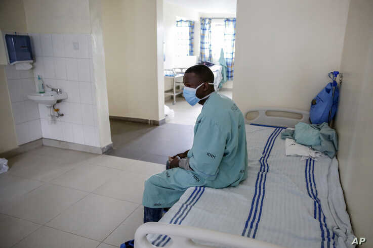 A patient sits in a ward for those who have tested positive for the new coronavirus, at the infectious disease unit of Kenyatta National Hospital, in Nairobi, Kenya Friday, May 1, 2020.