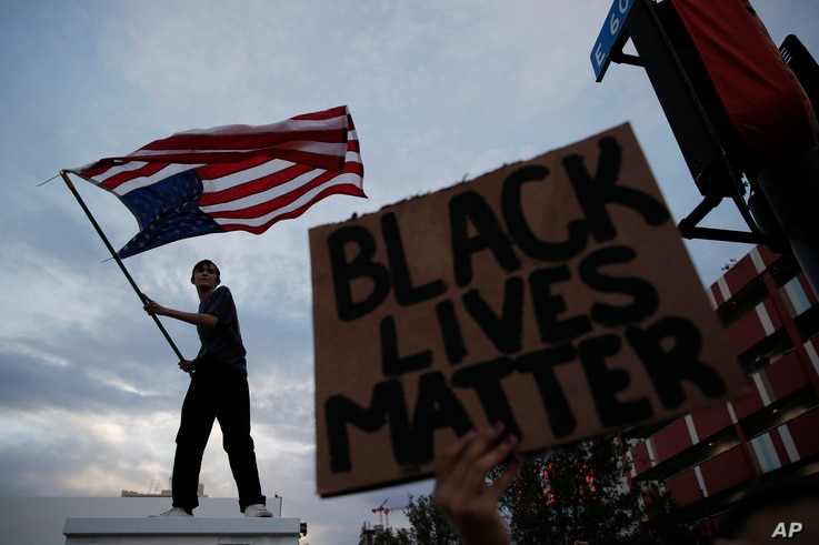 Protesters rally inn Las Vegas, Nevada, May 30, 202, over the death of George Floyd, a black man who was in police custody in Minneapolis.