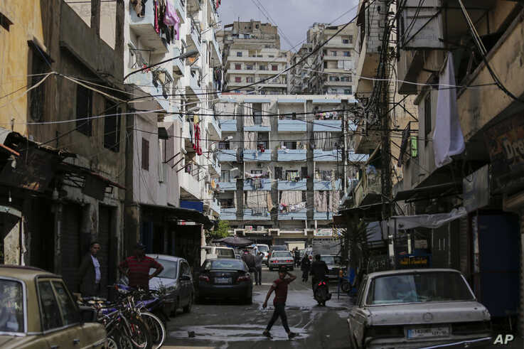 A boy crosses a street at Bab al-Tebanneh, one of Tripoli's poorest slums in the northern city, Lebanon, May 5, 2020.