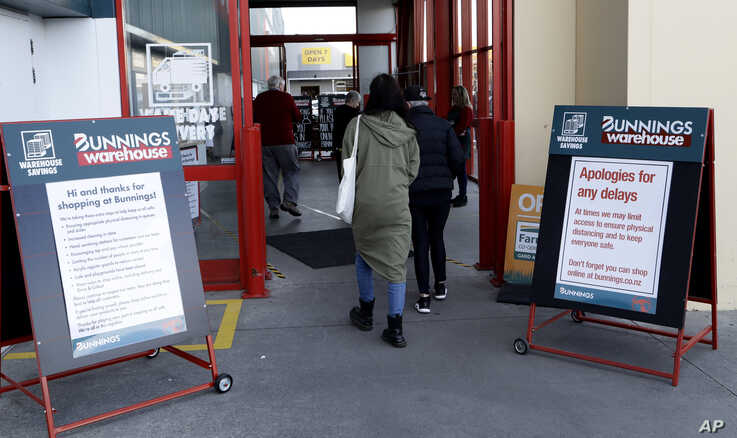 Customers enter a hardware store in Christchurch, New Zealand, May 14, 2020.