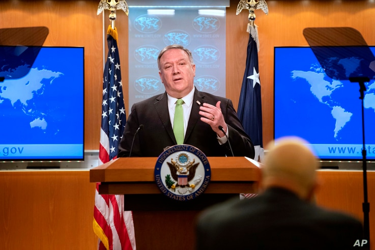 FILE - U.S. Secretary of State Mike Pompeo speaks during a press briefing at the State Department, in Washington, May 20, 2020.