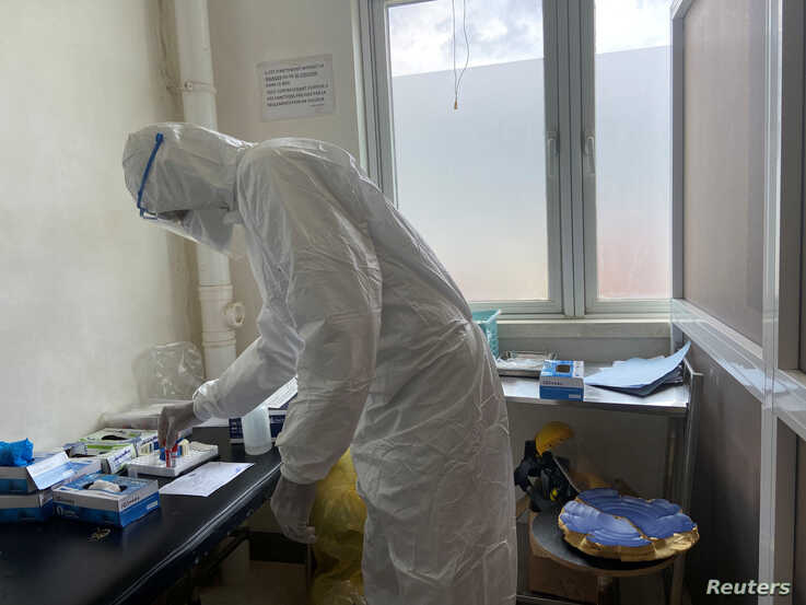 A member of medical staff wearing protective equipment, prepares to take care of patients amid the spread of the coronavirus disease (COVID-19), at an hospital in Douala, Cameroon, April 27, 2020.