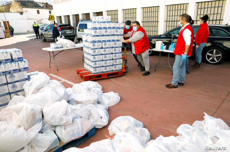 Members of the Spanish Red Cross prepare food for families in need at a food bank, as part of a special food distribution campaign, during the COVID-19 outbreak in Ronda, southern Spain, April 3, 2020.