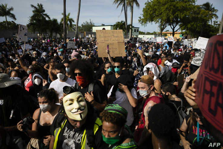 Protestors gather at Fort Lauderdale Police Department during a rally in response to the recent death of George Floyd in Fort…