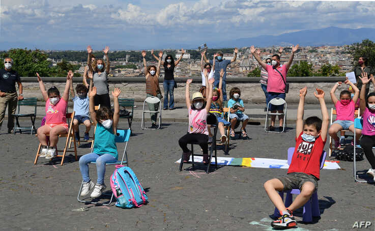 """Parents and children from Rome's public primary and secondary school """"IC Largo Oriani"""" take part in a flashmob entitled """"Open…"""