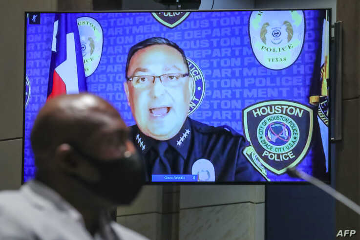 Houston Police Chief Art Acevedo (R) gives his opening statement as George Floyd's brother Philonise Floyd (L) listens during a…