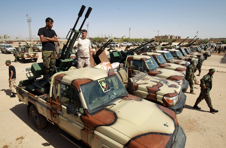 Members of the self-proclaimed eastern Libyan National Army (LNA) special forces gather in the city of Benghazi, on their way…