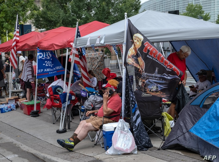 Supporters of US President Donald Trump camp near the BOK Center on June 19, 2020, in Tulsa, Oklahoma. - Trump will hold his…