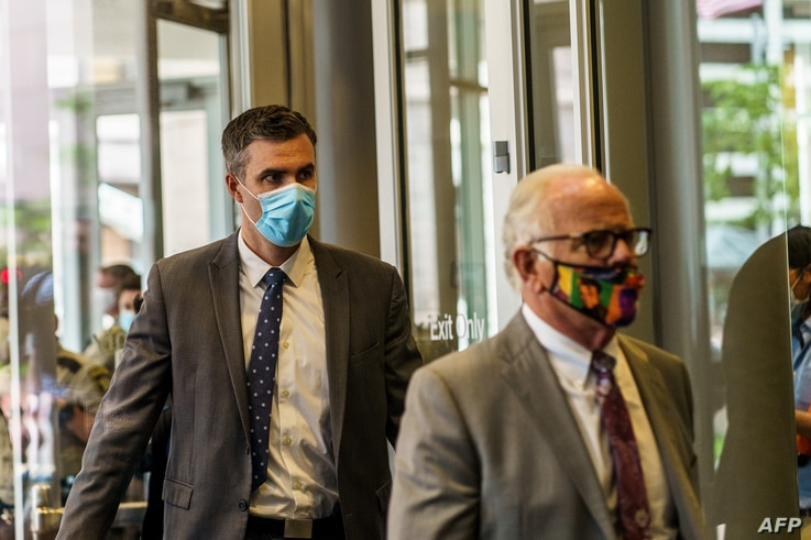 Former Minneapolis policeman Thomas Lane and his attorney exits the Hennepin County Public Safety Facility after the first…