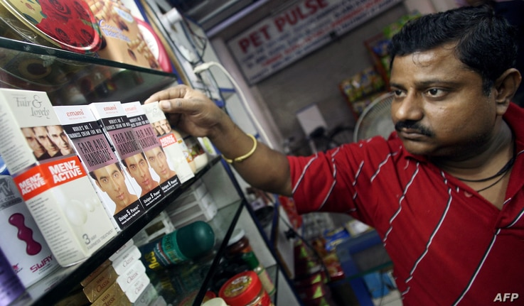 TO GO WITH 'INDIA-LIFESTYLE-CONSUMER-RETAIL'An Indian salesman arranges men fairness products at a shop in New Delhi, 04…