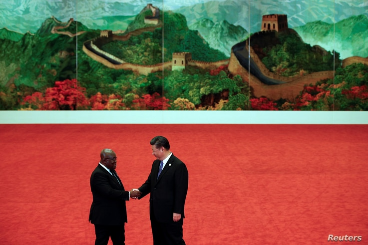 Ghana's President Nana Akufo-Addo, left, shakes hands with Chinese President Xi Jinping during the Forum on China-Africa…