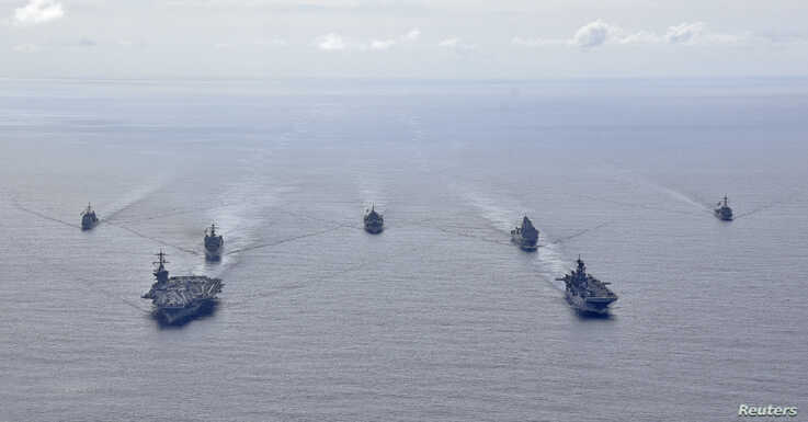 U.S. Navy ships from the Theodore Roosevelt Carrier Strike Group, the America Expeditionary Strike Group, and the U.S. 7th…