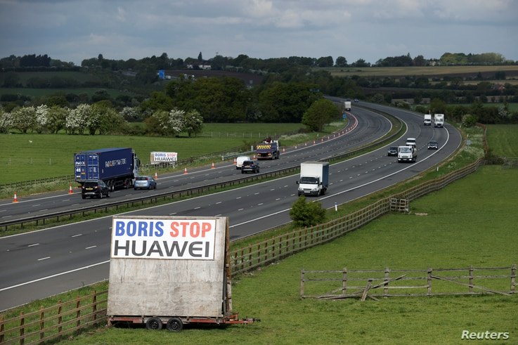 "A sign reading ""Boris Stop Huawei"" is seen next to the M40 motorway, following the outbreak of the coronavirus disease (COVID…"