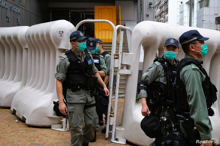 Riot police are seen during a march against new security laws, near China's Liaison Office, in Hong Kong, China May 22, 2020…