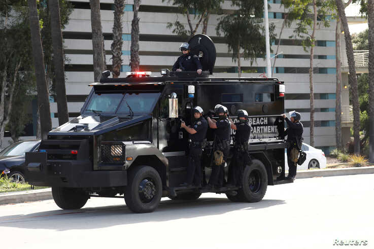 FILE PHOTO: Police in riot gear are seen on an armoured vehicle during nationwide unrest following the death in Minneapolis…